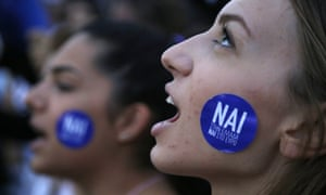 A supporter of the yes vote in the upcoming referendum at a rally outside the Greek parliament on Tuesday. The sticker reads: 'Yes to Greece, yes to euro.'