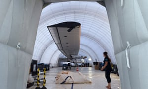 An inflatable hangar covers Solar Impulse after it was damaged by wind as it sat on the tarmac in Japan.