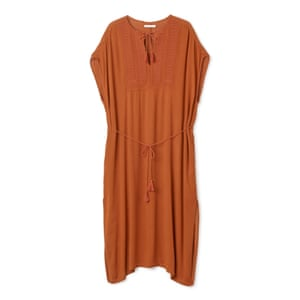 50 best summer dresses - deep teracotta orange relaxed knee length dress with thin waist tie and embroidery on neck by Weekday