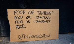 Cardboard sign reading 'food or tampons'