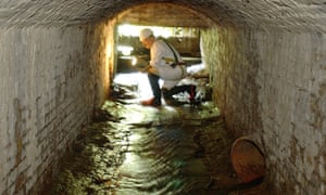 A worker by the entrance to a sewer in Hyde Park, west London. The capital had the most cocaine in its waste water in Europe.