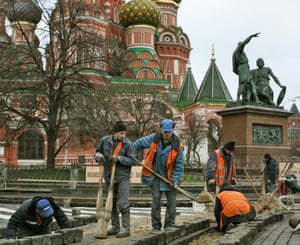 Migrant workers pave Red Square outside St Basil's Cathedral.