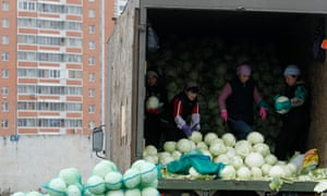 Tajik migrant workers unload cabbages at a vegetable market in the Moscow suburbs.