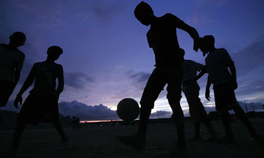 Children play football in Angola