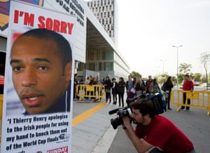 A cameraman films a poster of Thierry Henry in Barcelona in 2009.