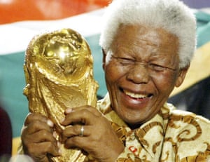 Nelson Mandela lifts the World Cup trophy in Zurich, Switzerland, after Fifa's announcement that South Africa would host the 2010 World Cup.