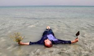 Bill Drummond lying in the Dead Sea.