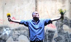 Bill Drummond standing under Spaghetti Junction, Birmingham, UK.