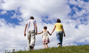 Parents with daughter, hand in hand.
