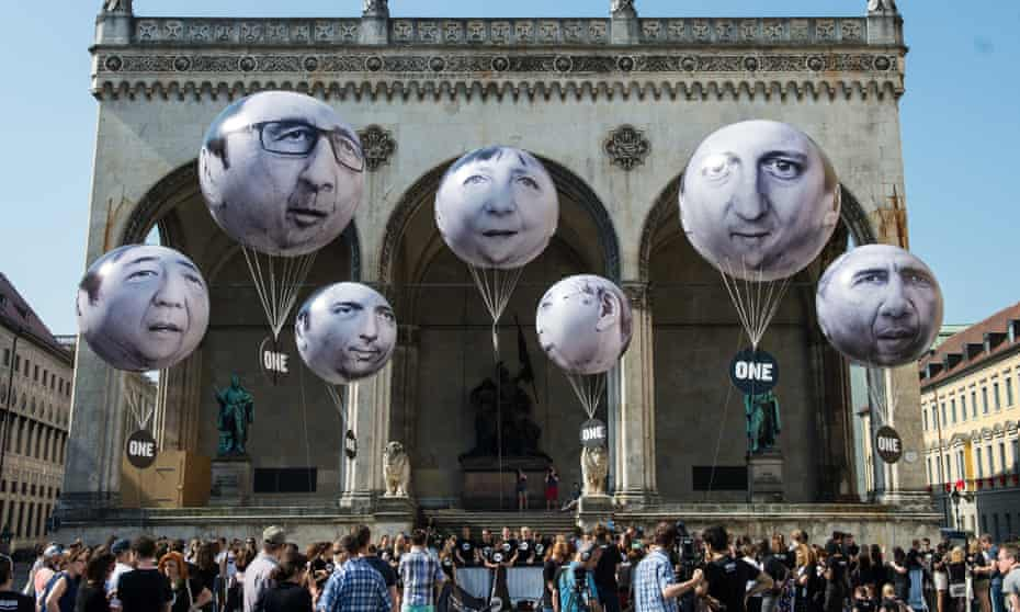 Activists decorate balloons with the faces of, left to right, Shinzo Abe, François Hollande, Matteo Renzi, Angela Merkel, Stephen Harper, David Cameron and Barack Obama during a protest against the G7 summit on Friday in Munich.