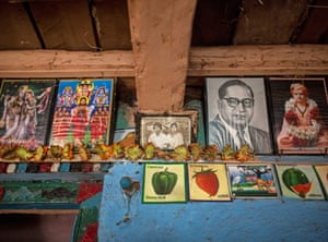 An old photo of Namdeo and Bagabai (C) hangs on a wall inside the house