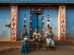 Namdeo poses with his wives Shivarti (L) and Bagabai (R) outside their house in Denganmal village, Maharashtra, India<br><br><strong>All
