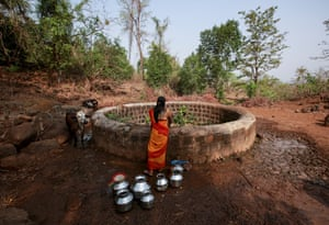 A woman fetches water from a well