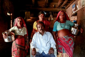 Bhagat, 66, poses with his wives, Sakhri, Tuki and Bhaagi (L to R) inside their house