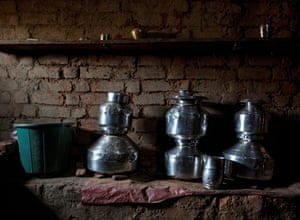 Metal pitchers used for storing water are seen in a room in Bhagat's house