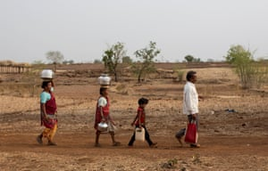Bhaagi (L) and Sakhri (2nd from L) walk to fetch water from a well