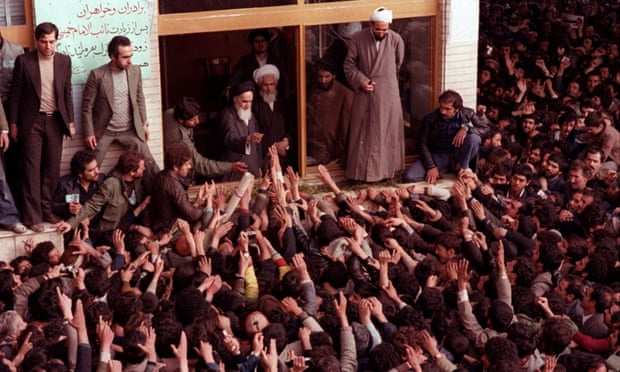 The late Ayatollah Ruhollah Khomeini, center, is greeted by supporters after arriving at the airport in Tehran on 1 February 1979.