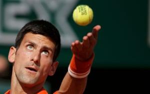 Novak Djokovic serves.