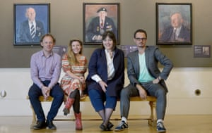 L to R: Artists James Lloyd, Clara Drummond, Catherine Goodman and Jonathan Yeo pose in front of portraits of Sgt Thomas Burke by Lloyd, trooper Cecil Newton by Peter Kuhfield and pilot Laurence Weeden by Martin Yeoman.