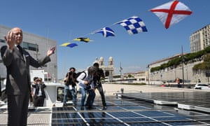 Laurent Fabius on PlanetSolar, the world's largest solar-powered boat, in Marseille. He called for more investment in renewable energy, suggesting it could allow sub-Saharan Africa to bypass the need for fossil fuels.