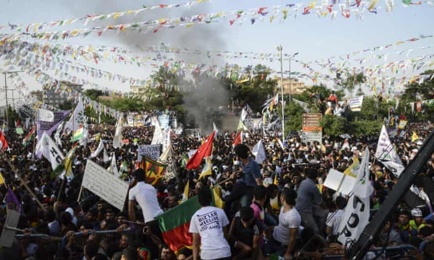 HDP supporters look at smoke from an apparent explosion during a rally in Diyarbakir on Friday.
