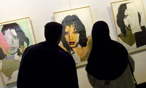 Iranians look at Andy Wharhol's portraits of rock star Mick Jagger during an exhibition of Pop Art at the Museum of Contemporary Art in Tehran, Iran.