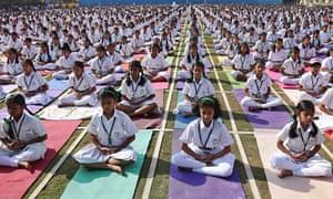 Indian schoolchildren practise yoga at Delhi Public School in Hyderabad.