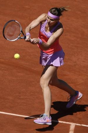 Lucie Safarova smacks a return back to Williams.