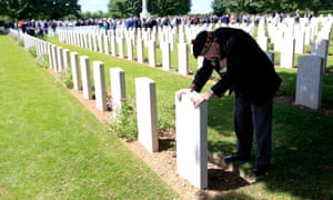 Neville Foot from Bury, Lancashire, at the grave of a comrade from the Scottish Horse Regiment at Bayeux war cemetery.