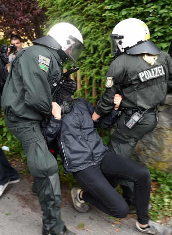 Protesters and police officers clash in Garmisch-Partenkirchen.