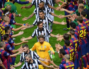Juventus players recieve a guard of honour from the Barcelona team as the go up to receive their runners-up medals.
