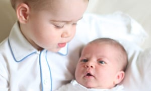 One of four pictures taken by Kate, Duchess of Cambridge, of baby Princess Charlotte being held by her brother, two-year-old Prince George. Photograph: Duchess of Cambridge/AP
