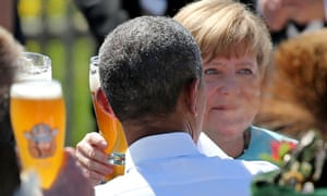 Obama and Merkel enjoy a beer at a breakfast meeting.
