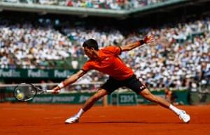 Novak Djokovic of Serbia plays a backhand.