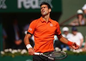 Novak Djokovic reacts to Wawrinka's play.