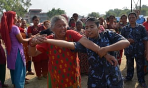 Nepalese police officers conduct a self defence training session for women and children at a shelter for earthquake victims in Kathmandu.
