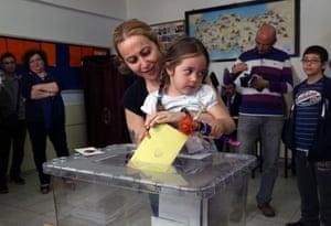 Woman casting vote in Ankara