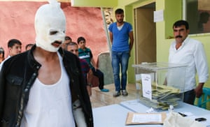 Huseyin Toprak casts his vote at a polling station in Diyarbakir