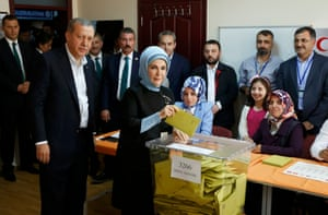 Recep Tayyip Erdoğan and his wife, Emine, as she casts her vote
