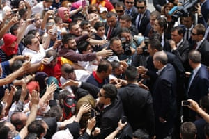 Recep Tayyip Erdoğan shakes hands with supporters of the ruling AKP