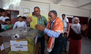 A man casts his vote in Carikli village outside Diyarbakir