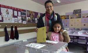 Elif Incekara casts her mother's vote at a polling station in Ankara