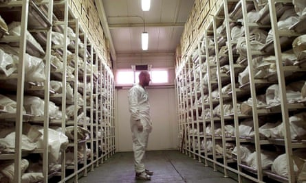 A forensic expert inspects bags containing bodies of people believed killed in the Srebrenica massacre: if it had been available, the eyeWitness to Atrocities app may have helped in collecting evidence against those responsible.