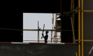 A labourer works at a construction site in Beijing.