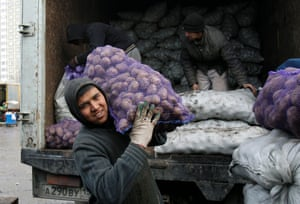 Tajik migrant workers at a vegetable market on the outskirts of Moscow.