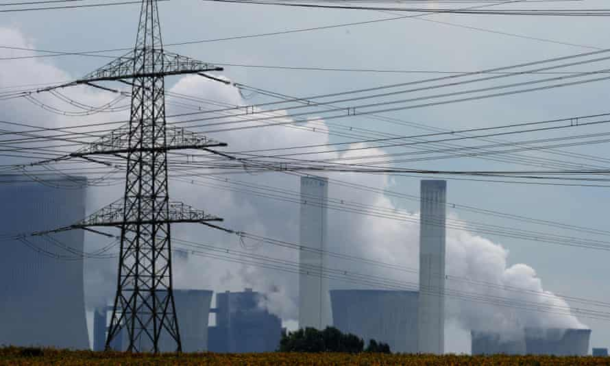 Exhaust rises from cooling towers at the new Neurath lignit coal-fired power station at Grevenbroich near Aachen, western Germany.