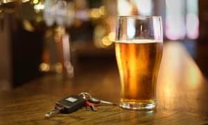 car keys next to a pint of beer