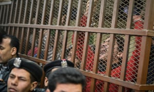"Defendants celebrate at a court in Cairo following the acquittal of 26 male men accused of ""debauchery"" after they were arrested in a aid on a bathhouse in the Egyptian capital."