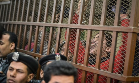 Defendants celebrate at a court in Cairo following the acquittal of 26 male men accused of
