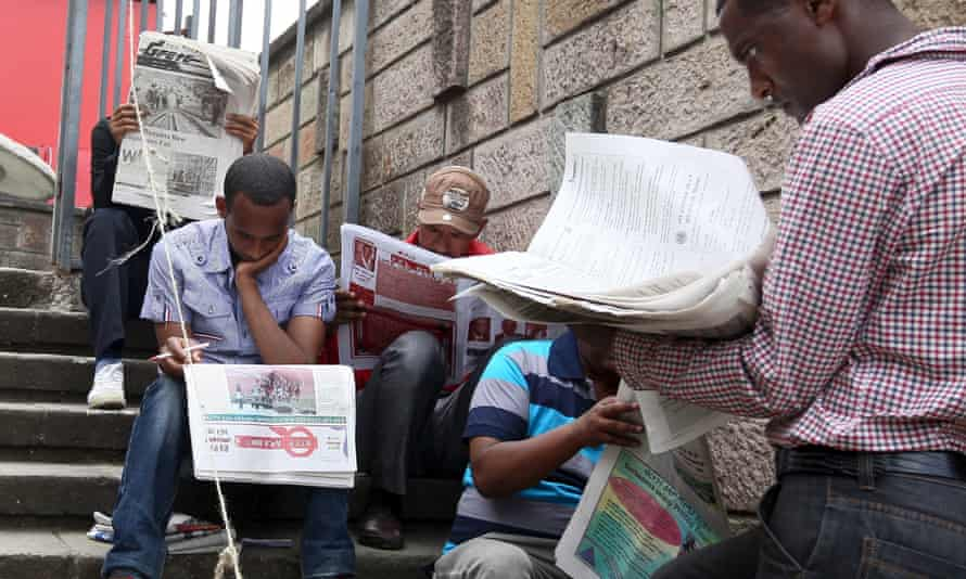 Ethiopian people read newspapers a day before the country goes into a general election in capital Addis Ababa